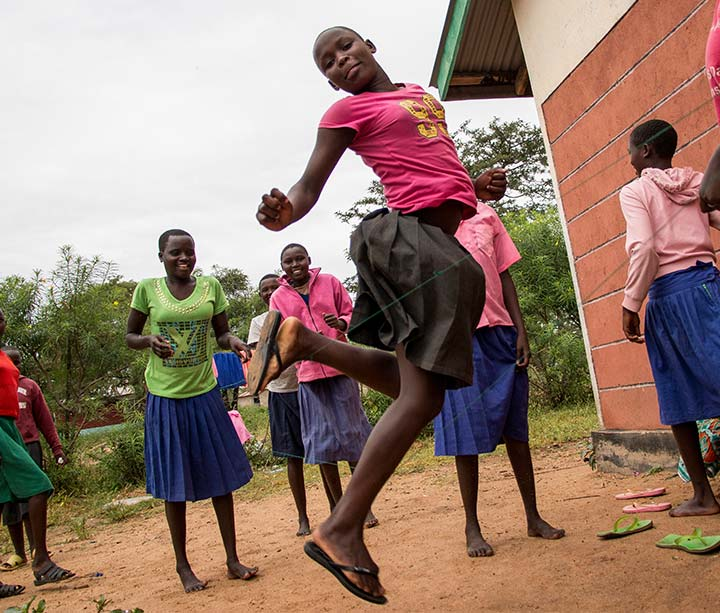 Teeenage Kenyan girls playing in the compound of their ActionAid-supported school in West Pokot, Kenya