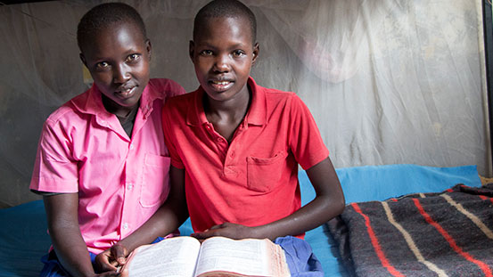Abigail, 14, and Purity, 13, are childhood friends from Kenya.