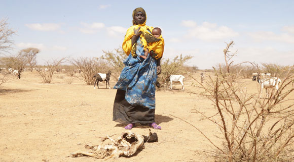 Nimo holds her child in Somaliland