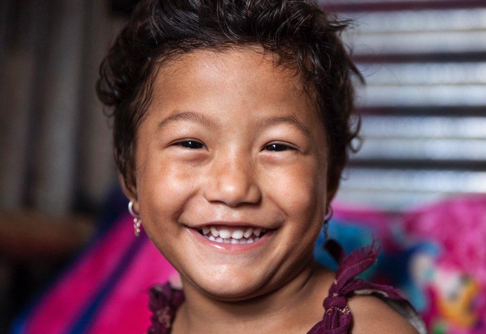 Krishla smiles, her injury healed.