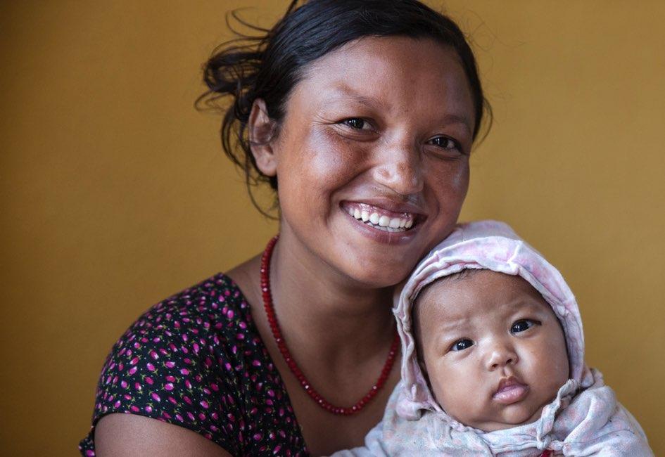 Shreya holds her beautiful baby girl, Sushreya.