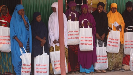 Women collect sanitary towels as part of our dignity kit distribution.