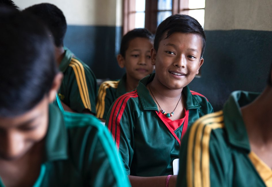 """It feels good to be back in school because it gives us a chance to play with our friends and forget the distress caused by the quake,"" says Sumit."